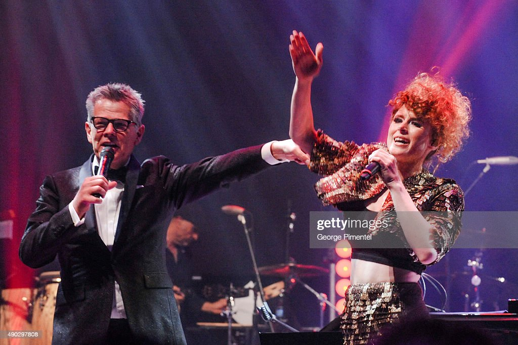 David Foster and Kiesza perform at the David Foster Foundation Miracle Gala And Concert held at Mattamy Athletic Centre on September 26, 2015 in Toronto, Canada.