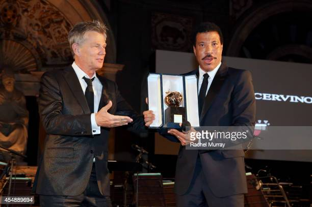 David Foster and Lionel Richie onstage during the Celebrity Fight Night gala celebrating Celebrity Fight Night In Italy benefitting The Andrea...