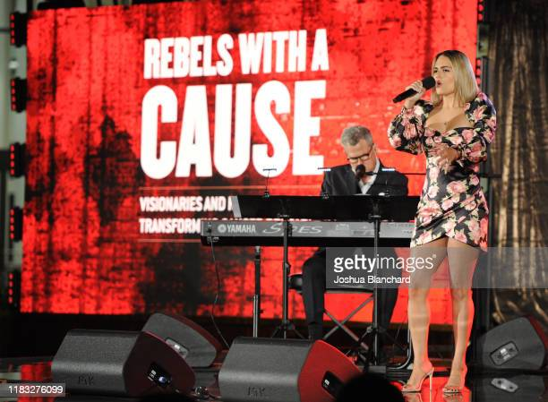 David Foster and Pia Toscano perform onstage during the Transformative Medicine of USC Rebels with a Cause GALA at on October 24 2019 in Santa Monica...