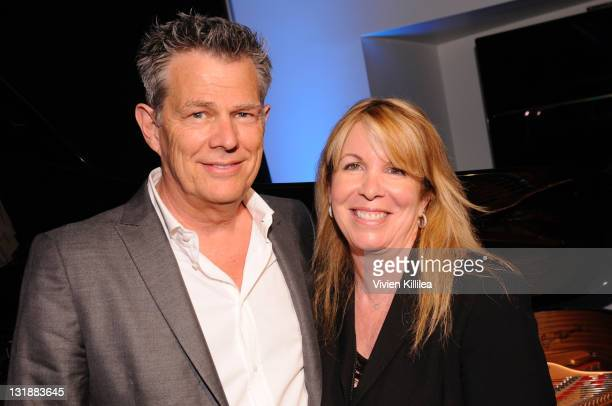 David Foster and publicist Cheryl Lynch attend An Intimate Evening With David Foster at Peer Music on April 4 2011 in Burbank California