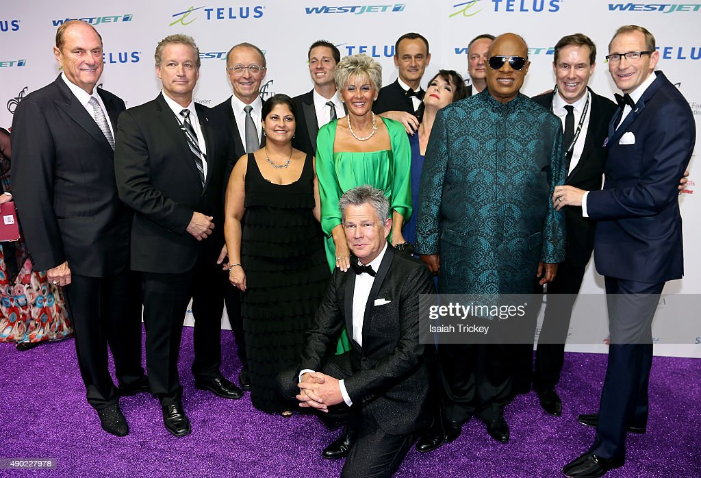 David Foster (Middle) and Stevie Wonder (R) with members of the David Foster Foundation arrive at the David Foster Foundation Miracle Gala And Concert at Mattamy Athletic Centre on September 26, 2015 in Toronto, Canada.