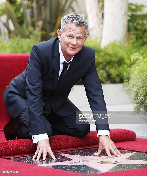 David Foster attends the ceremony honoring him with a Star on The Hollywood Walk of Fame held on May 31 2013 in Hollywood California