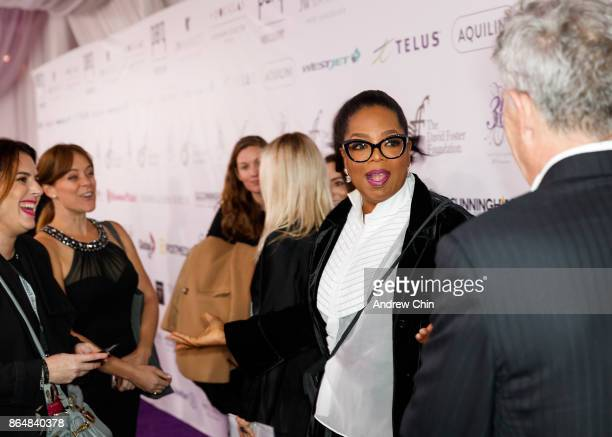 David Foster greets Oprah Winfrey during the David Foster Foundation Gala at Rogers Arena on October 21 2017 in Vancouver Canada