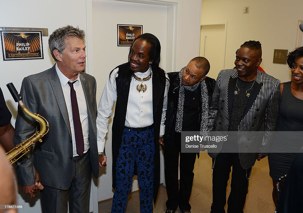 David Foster joins Earth, Wind & Fire founding members Verdine White, Ralph Johnson and Philip Bailey during prayer circle before their HSN Live broadcast special at The Venetian Las Vegas on August 30, 2013 in Las Vegas, Nevada.