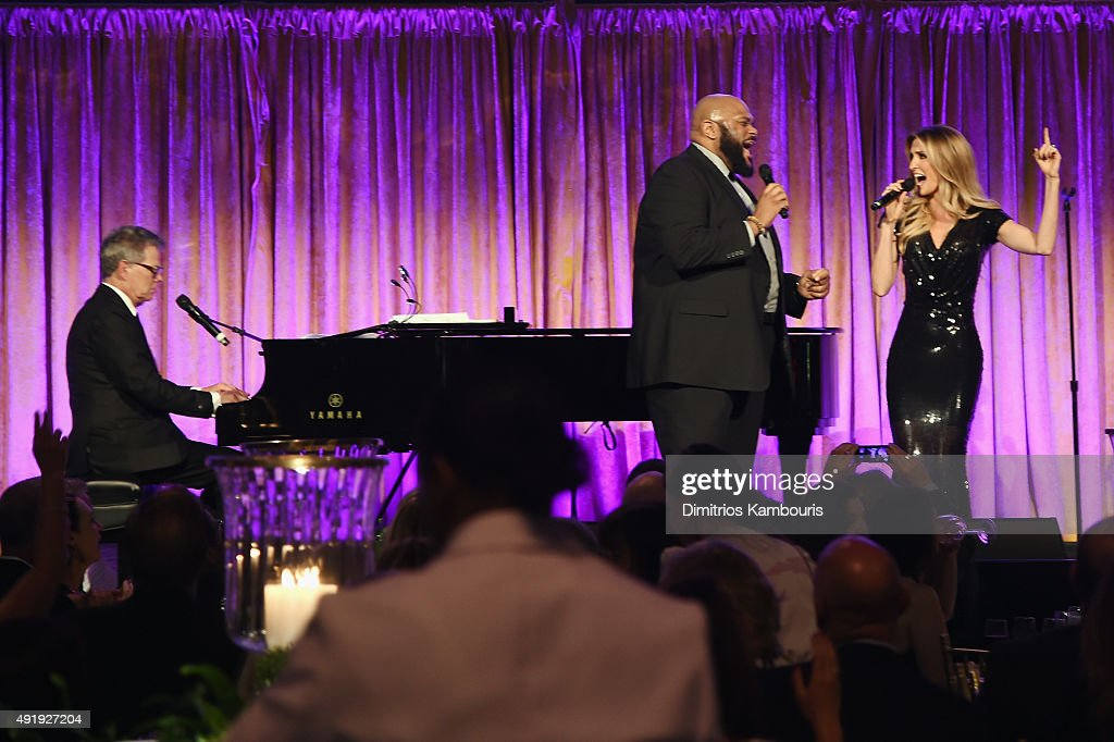 David Foster (L) performs onstage with Ruben Studdard and Kelly Levesque during the Global Lyme Alliance 'Uniting for a Lyme-Free World' Inaugural Gala at Cipriani 42nd Street on October 8, 2015 in New York City.