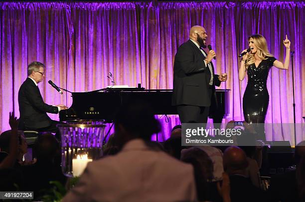 David Foster performs onstage with Ruben Studdard and Kelly Levesque during the Global Lyme Alliance 'Uniting for a LymeFree World' Inaugural Gala at...