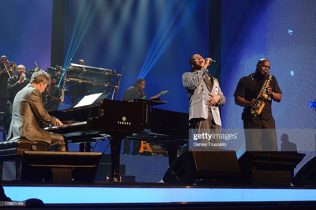 David Foster performs with Earth, Wind & Fire during debut of new CD for HSN Live broadcast special at The Venetian Las Vegas on August 30, 2013 in Las Vegas, Nevada.