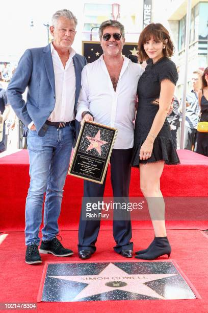 David Foster, Simon Cowell and Katharine McPhee attend a ceremony honoring Cowell with a star on the Hollywood Walk of Fame on August 22, 2018 in...