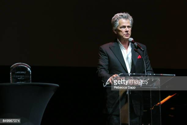 David Foster speaks onstage at 2017 GRAMMY Museum Gala Honoring David Foster at The Novo by Microsoft on September 19 2017 in Los Angeles California