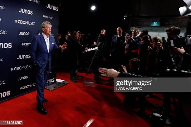 David Foster with the David Foster Foundation arrives on the red carpet for the Juno Music Awards at Budweiser Gardens in London, Canada, March 17,...