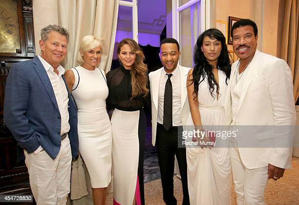 David Foster Yolanda Foster Chrissy Teigen John Legend Lisa Parigi and Lionel Richie attend the white party dinner hosted by Andrea and Veronica...