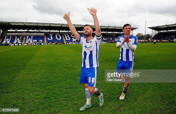 David Fox of Colchester United celebrates after the final whistle as his team avoid relegation following the Sky Bet League One match between...