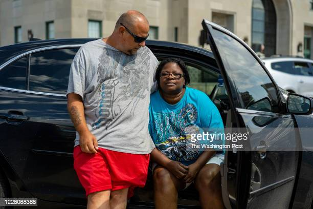 David Frantz and Pamela Elliott wait outside a shelter set up by the American Red Cross at the Veterans Memorial Building in Cedar Rapids, Iowa on...