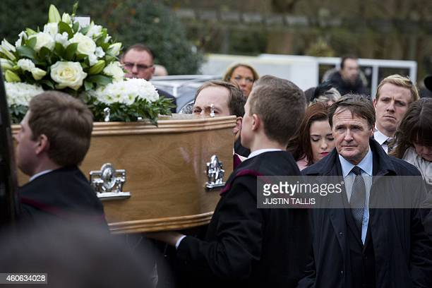 David Fraser son of British gangster Frankie Fraser arrives his father's funeral as palbearers carry the coffin at Honor Oak Crematorium in south...