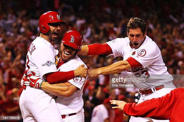David Freese and Daniel Descalso and Matt Holliday of the St Louis Cardinals celebrate their to 2 win over the Los Angeles Dodgers in Game One of the...