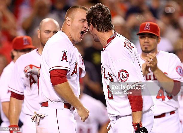 David Freese and Mike Trout of the Los Angeles Angels of Anaheim celebrate after Freese hit a walk off solo home run in the ninth inning against the...