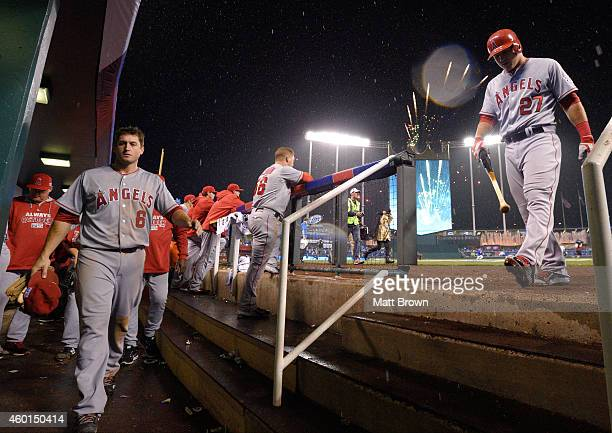 David Freese and Mike Trout of the Los Angeles Angels of Anaheim walk towards the clubhouse after losing game 3 of the American League Division...