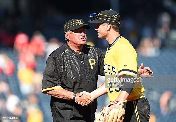 David Freese is congratulated by manager Clint Hurdle of the Pittsburgh Pirates after a 93 win over the Milwaukee Brewers on April 17 2016 at PNC...