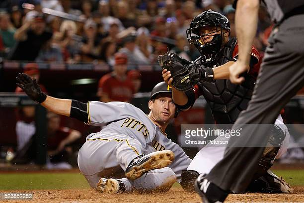 David Freese of the Arizona Diamondbacks reacts after being tagged out at home plate by catcher Welington Castillo of the Arizona Diamondbacks during...