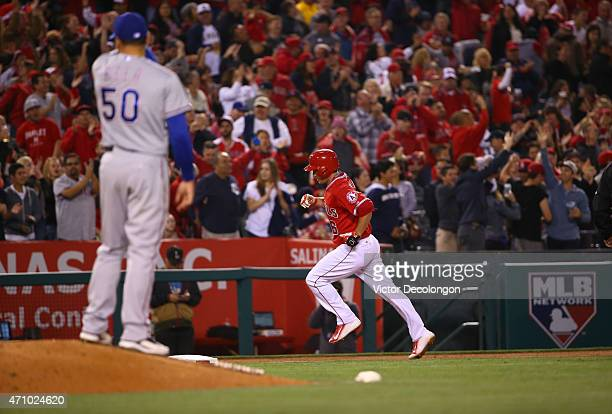 David Freese of the Los Angeles Angels of Anaheim rounds third base after hitting a tworun homerun in the seventh inning against relief pitcher Keone...