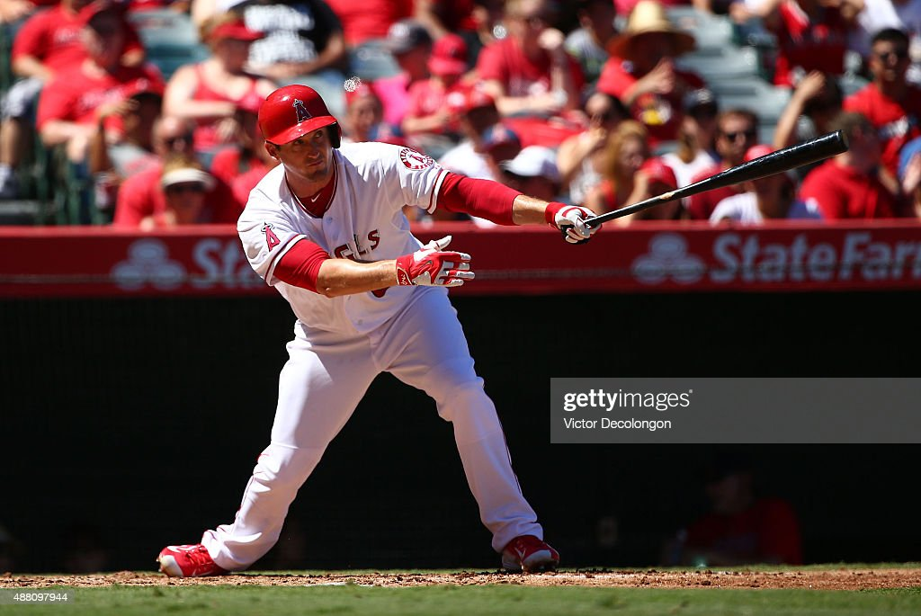 David Freese #6 of the Los Angeles Angels of Anaheim watches the ball go for a single to right field in the second inning against the Houston Astros during the MLB game at Angel Stadium of Anaheim on September 13, 2015 in Anaheim, California.
