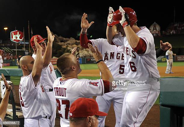 David Freese of the Los Angeles Angels returns to the dugout after hitting a solo home run against the Kansas City Royals in the fifth inning during...