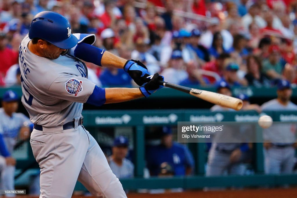 David Freese #25 of the Los Angeles Dodgers bats in two runs with a triple against the St. Louis Cardinals in the first inning at Busch Stadium on September 13, 2018 in St. Louis, Missouri.