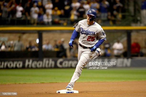 David Freese of the Los Angeles Dodgers celebrates after hitting a solo home run against Wade Miley of the Milwaukee Brewers during the first inning...