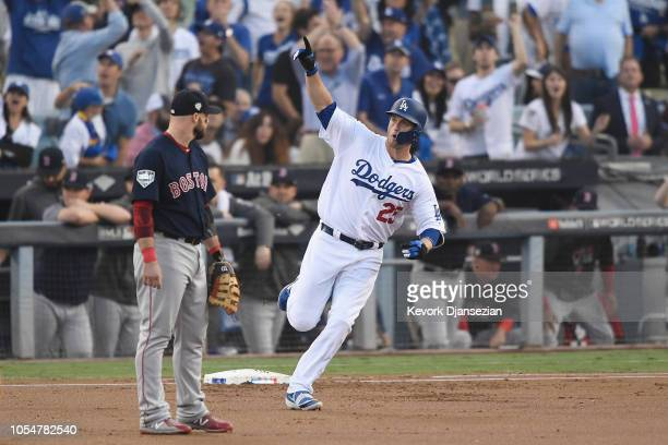 David Freese of the Los Angeles Dodgers celebrates his first inning home run as Steve Pearce of the Boston Red Sox looks on in Game Five of the 2018...