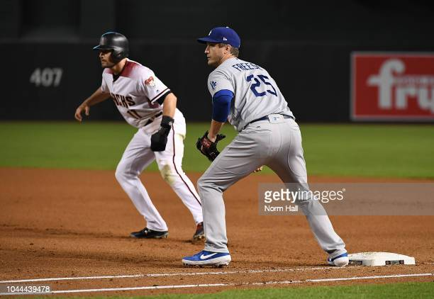 David Freese of the Los Angeles Dodgers covers first base as AJ Pollock of the Arizona Diamondbacks takes a lead at Chase Field on September 24 2018...