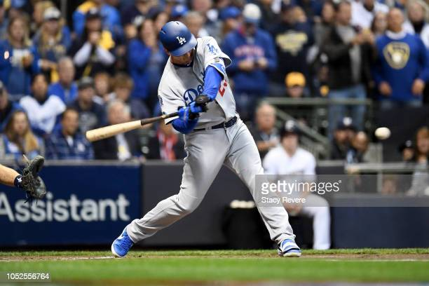 David Freese of the Los Angeles Dodgers hits a solo home run against Wade Miley of the Milwaukee Brewers during the first inning in Game Six of the...
