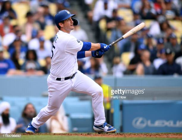 David Freese of the Los Angeles Dodgers reacts to his solo homerun to take a 1-0 lead over the Philadelphia Phillies during the seventh inning at...