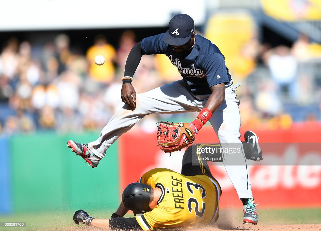 David Freese #23 of the Pittsburgh Pirates breaks up a double play attempt by Brandon Phillips #4 of the Atlanta Braves during the ninth inning at PNC Park on April 9, 2017 in Pittsburgh, Pennsylvania.