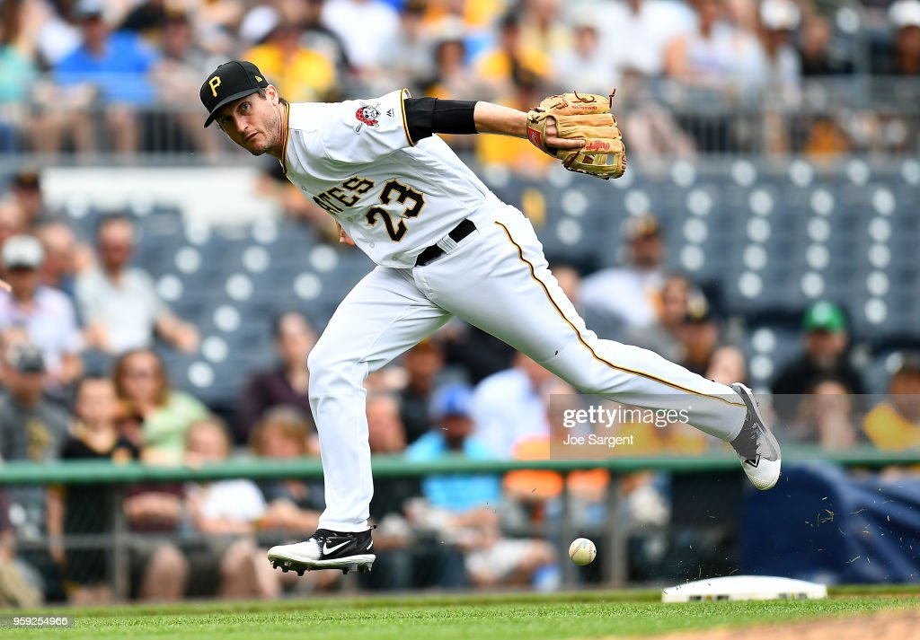 David Freese #23 of the Pittsburgh Pirates can't field a ball hit by Adam Engel #15 of the Chicago White Sox (not pictured) in the sixth inning during inter-league play at PNC Park on May 16, 2018 in Pittsburgh, Pennsylvania.