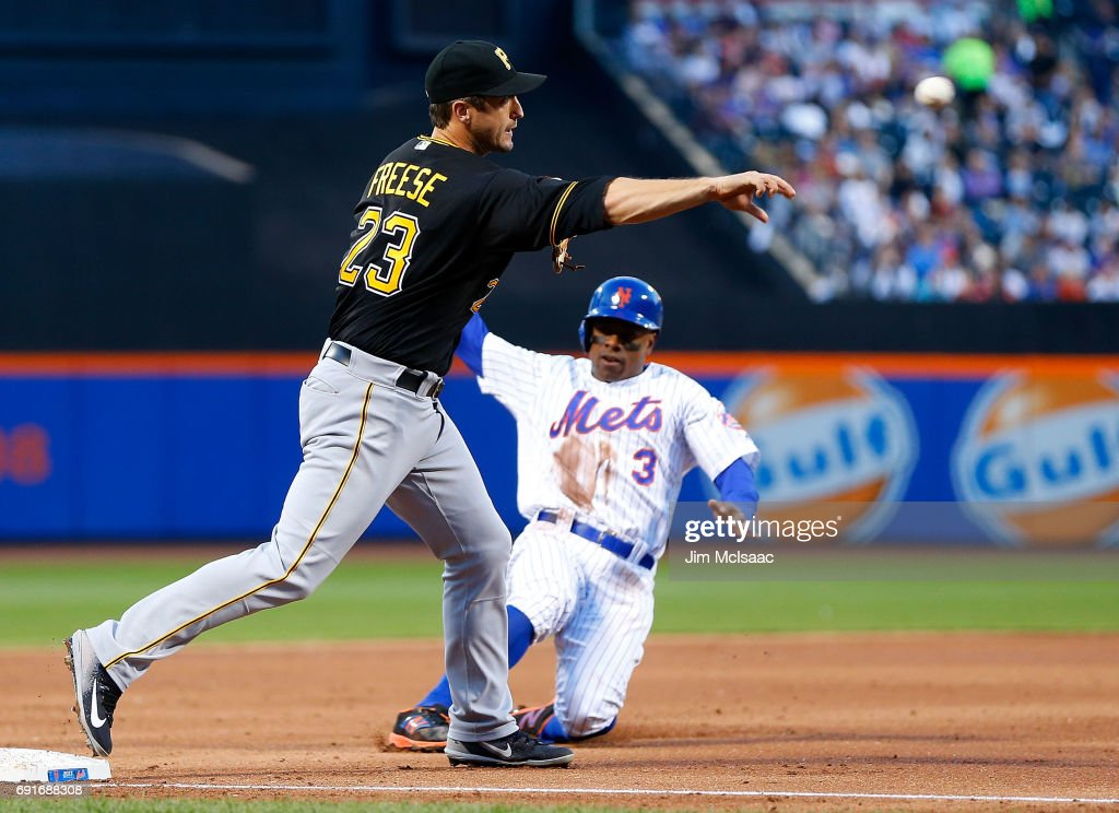 David Freese #23 of the Pittsburgh Pirates completes a second inning ending double play after forcing out Curtis Granderson #3 of the New York Mets at third base at Citi Field on June 2, 2017 in the Flushing neighborhood of the Queens borough of New York City.