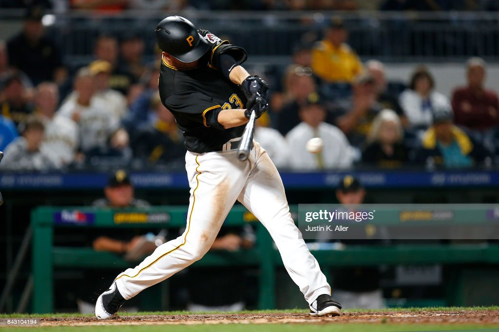 David Freese #23 of the Pittsburgh Pirates hits a RBI single in the eighth inning against the Chicago Cubs at PNC Park on September 5, 2017 in Pittsburgh, Pennsylvania.