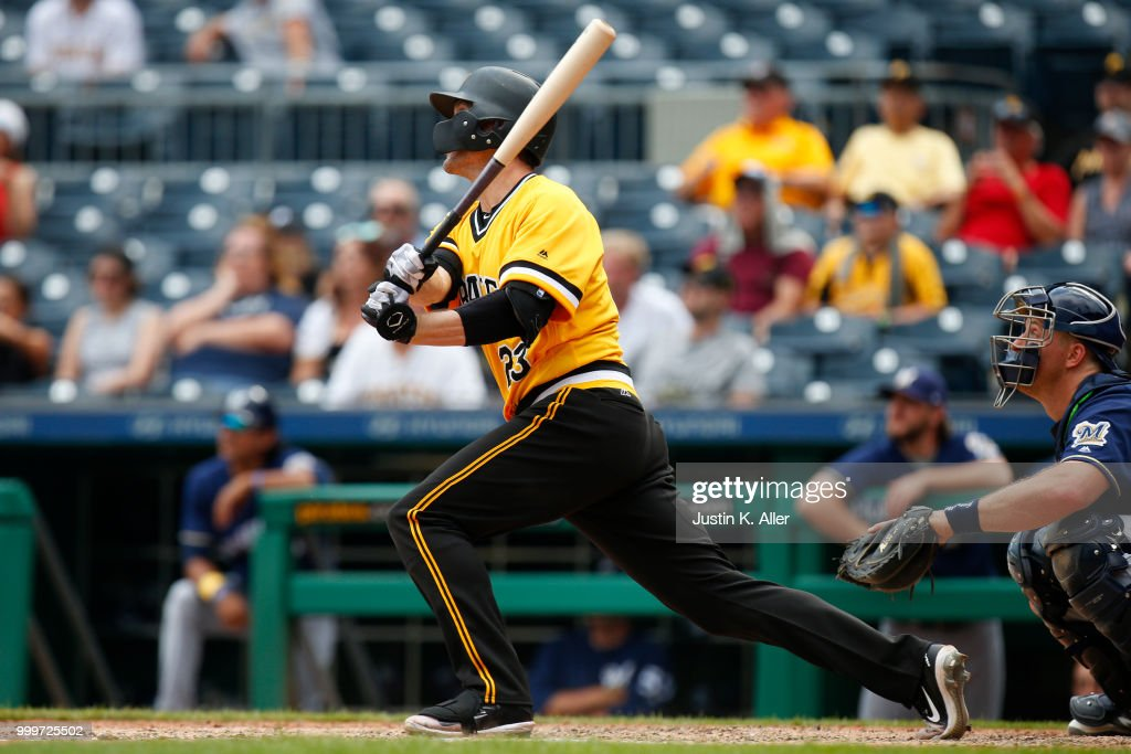 David Freese #23 of the Pittsburgh Pirates hits a RBI triple in the ninth inning against the Milwaukee Brewers at PNC Park on July 15, 2018 in Pittsburgh, Pennsylvania.