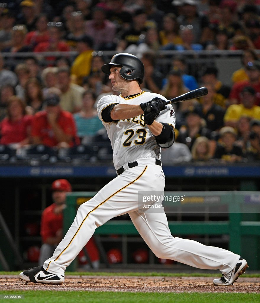 David Freese #23 of the Pittsburgh Pirates hits an two run RBI single to center field in the first inning during the game against the St. Louis Cardinals at PNC Park on September 23, 2017 in Pittsburgh, Pennsylvania.
