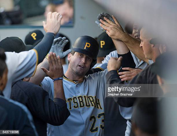David Freese of the Pittsburgh Pirates is congratulated by teammates after hitting a solo home run off of starting pitcher Wade Miley of the Seattle...