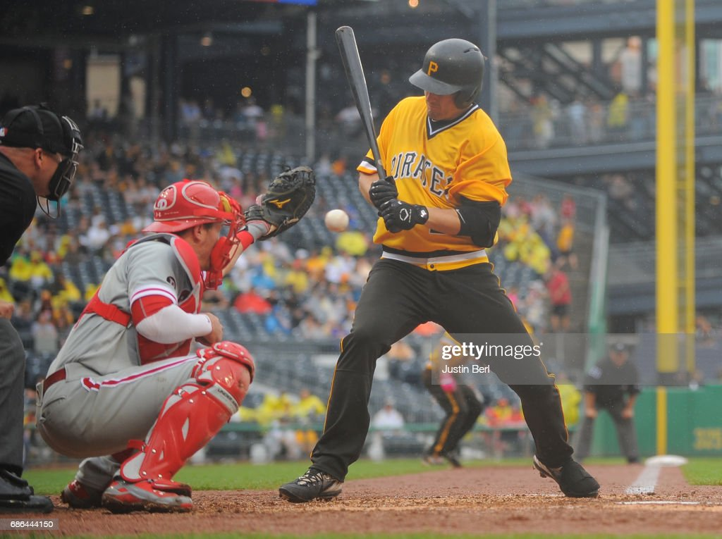 David Freese #23 of the Pittsburgh Pirates is hit by a pitch with the bases loaded to score a run in the sixth inning during the game against the Philadelphia Phillies at PNC Park on May 21, 2017 in Pittsburgh, Pennsylvania.