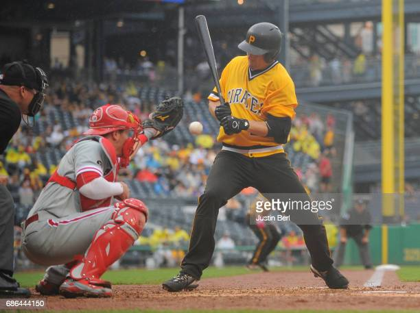 David Freese of the Pittsburgh Pirates is hit by a pitch with the bases loaded to score a run in the sixth inning during the game against the...