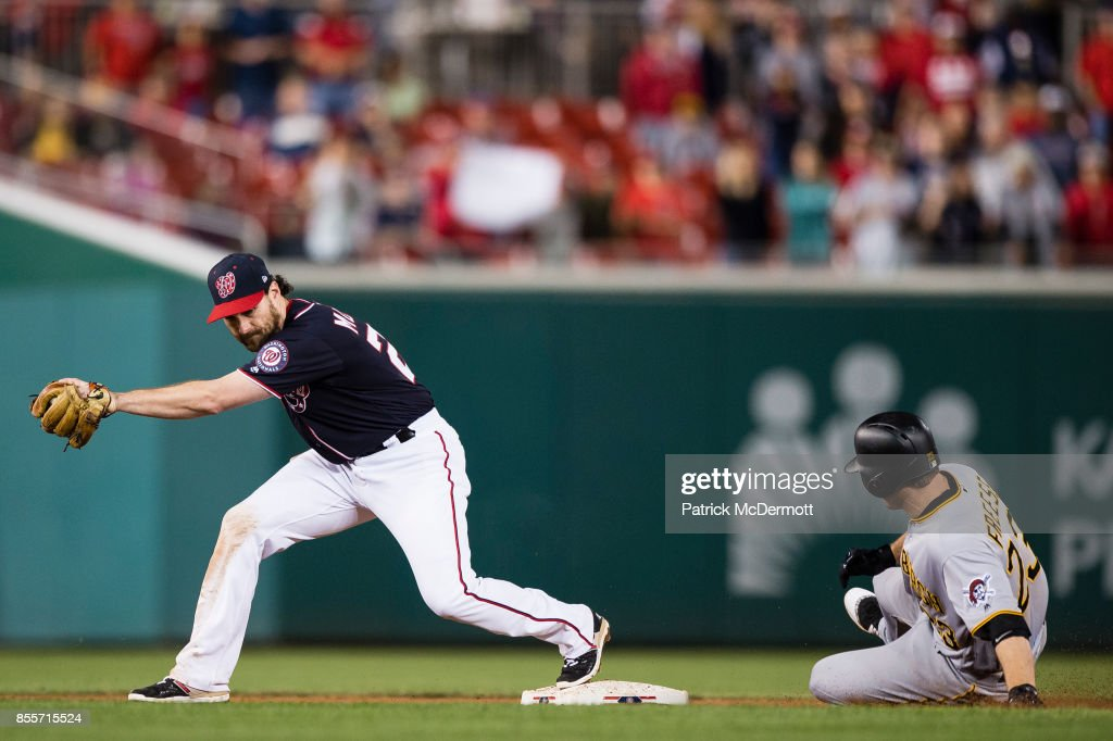 David Freese #23 of the Pittsburgh Pirates is out at second base on a fielder's choice as Daniel Murphy #20 of the Washington Nationals makes the catch for the final out of the game in the ninth inning at Nationals Park on September 29, 2017 in Washington, DC.