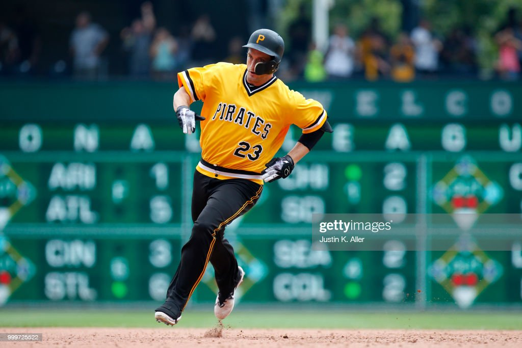 David Freese #23 of the Pittsburgh Pirates rounds second heading for a RBI triple in the ninth inning against the Milwaukee Brewers at PNC Park on July 15, 2018 in Pittsburgh, Pennsylvania.
