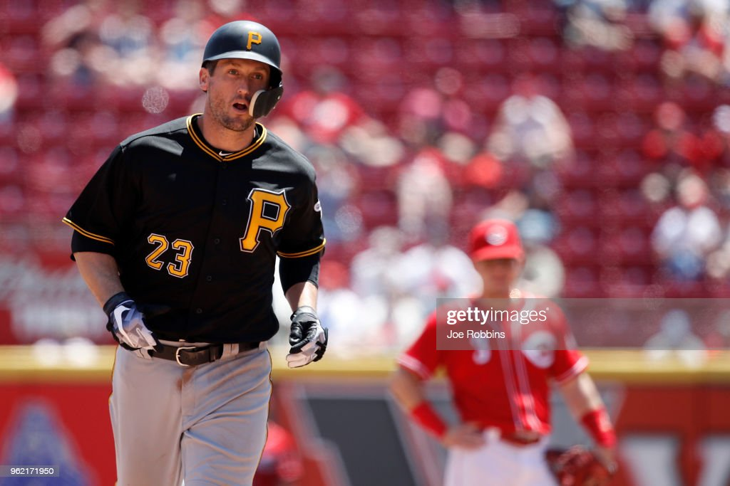 David Freese #23 of the Pittsburgh Pirates rounds the bases after hitting a two-run home run in the sixth inning against the Cincinnati Reds at Great American Ball Park on May 24, 2018 in Cincinnati, Ohio. The Reds won 5-4.