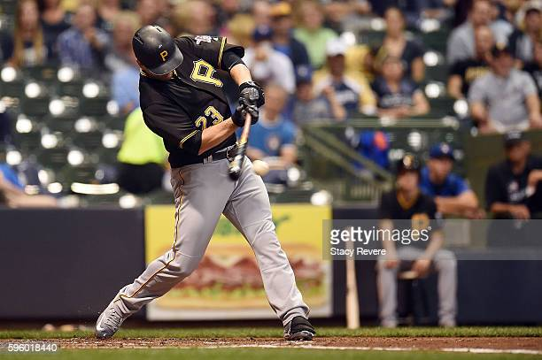David Freese of the Pittsburgh Pirates swings at a pitch during the fourth inning of a game against the Milwaukee Brewers at Miller Park on August 26...