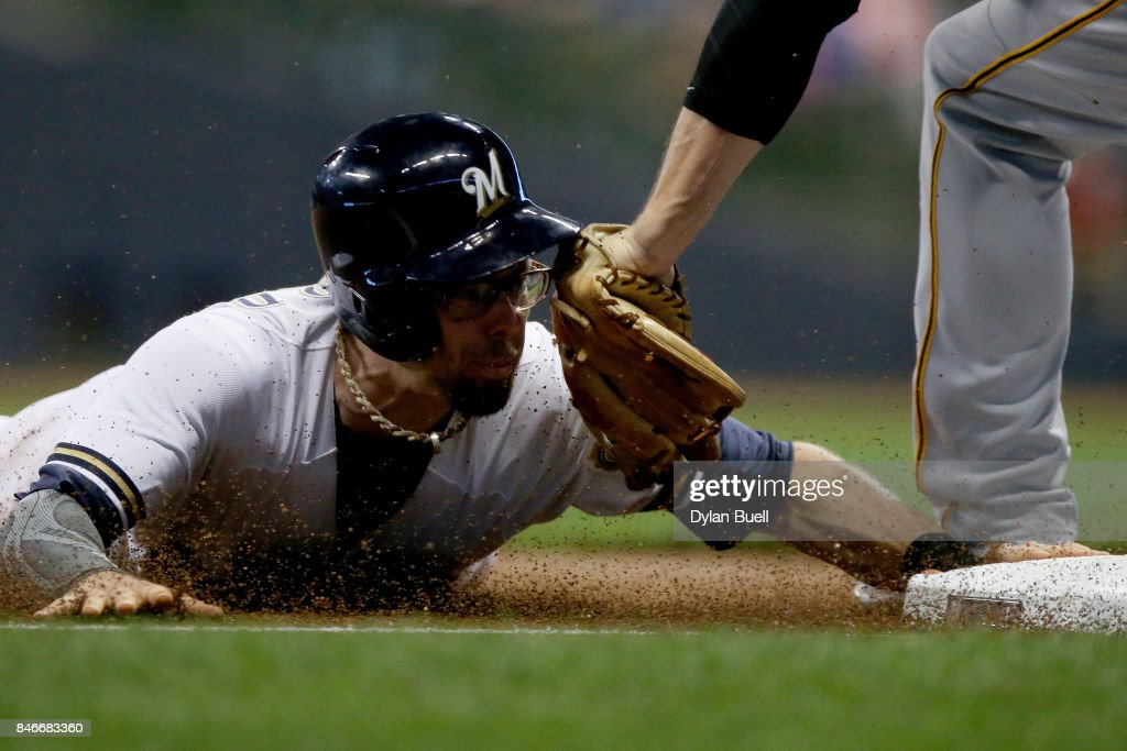 David Freese #23 of the Pittsburgh Pirates tags out Eric Sogard #18 of the Milwaukee Brewers during a steal attempt in the first inning at Miller Park on September 13, 2017 in Milwaukee, Wisconsin.