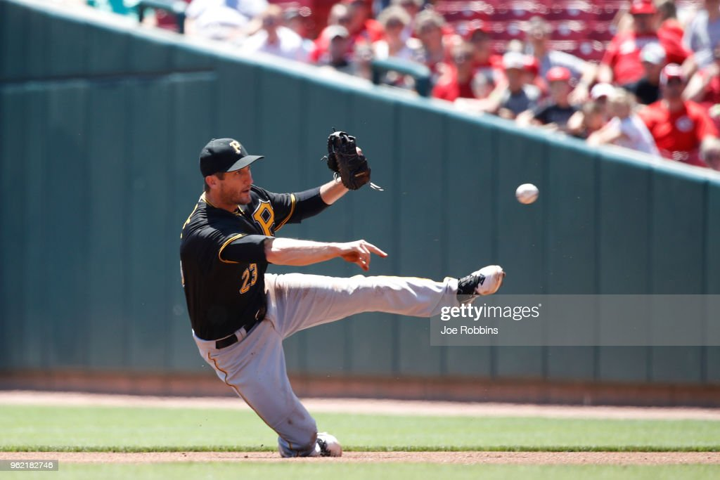 David Freese #23 of the Pittsburgh Pirates throws after fielding the ball in the second inning against the Cincinnati Reds at Great American Ball Park on May 24, 2018 in Cincinnati, Ohio. The Reds won 5-4.