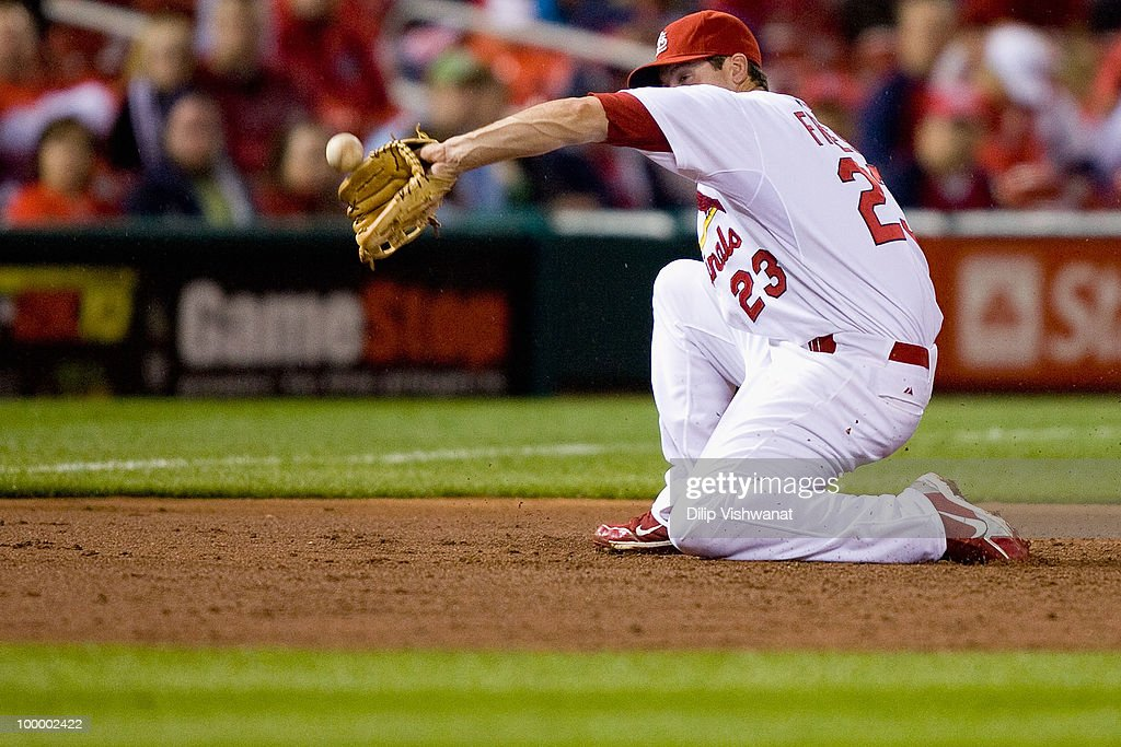 David Freese #23 of the St. Louis Cardinals attempts to field a line drive against the Florida Marlins at Busch Stadium on May 19, 2010 in St. Louis, Missouri. The Marlins beat the Cradinals 5-1.