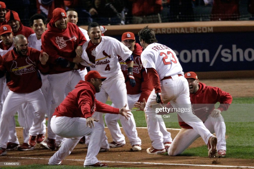 David Freese #23 of the St. Louis Cardinals celebrates at home plate after hitting a walk off solo home run in the 11th inning to win Game Six of the MLB World Series against the Texas Rangers at Busch Stadium on October 27, 2011 in St Louis, Missouri. The Cardinals won 10-9.