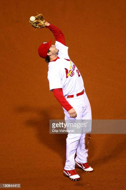 David Freese of the St Louis Cardinals drops an infield pop fly by Josh Hamilton of the Texas Rangers in the fifth inning during Game Six of the MLB...